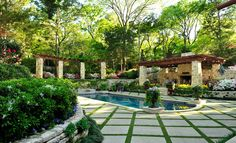 Poolandspa.com Traditional Swimming Pool with Pathway, Trellis, exterior stone floors. One can only DREAM!