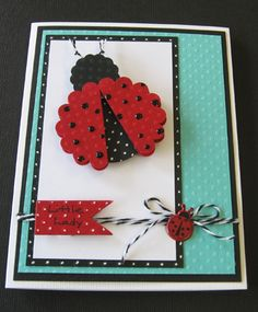 handmade card:Little Lady by daisynook ... punch art ladybug ... dots theme ... black pearl pen for lady bug ... white gel pen dots on black mat line and under ladybug's wing ... gorgeous colors .,.. white, red and aqua with black accents ... cute litte bug charm too ... great card! ...