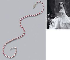 A RUBY, CULTURED PEARL AND DIAMOND NECKLACE  The line of graduated cultured pearls with ruby bead spacers to the diamond plaque clasp, circa 1930, 43.8 cm. long, in Garrard & Co. Ltd ~ from the Collection of H.R.H The Princess Margaret, Countess of Snowdon
