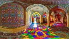 Nasir Al-Mulk Mosque, Shiraz, Iran  Built in 1888 it is considered to be a traditional mosque. However these incredible colored glass ornaments create a breathtaking site. When the sun shines through these windows, the whole space fills with elusive colorful light. Top 10 Arabic Architecture-Nasir-Photo by Omid Jafarnezhad