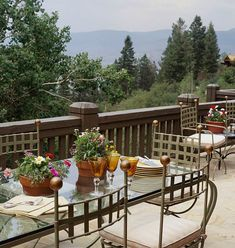 Those dining al fresco in this home are treated to a stunning mountain view. - Traditional Home ®/ Photo: Jon Jensen / Design: Jan Showers