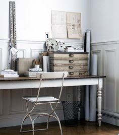 An all-white desk vignette with wood accents