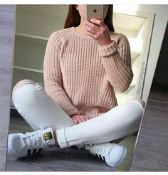 Peach jumper with ripped jeans and Adidas supestar's