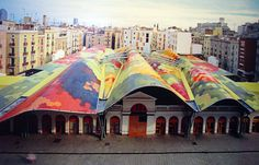 Food market in Barcelona has a restored roof made of 300,000 wave like multicolored ceramic hexagons that represent fruits and vegetables