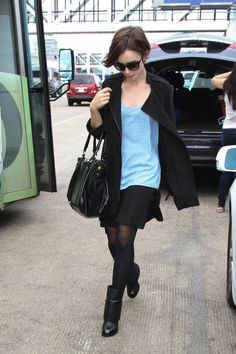 Lily Collins Mini Skirt - Lily Collins teamed her tank top with a swingy black mini skirt.