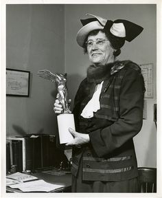Elise Depew Strang L'Esperance (1878-1959), Cornell University, shown here in 1951 with her Lasker Clinical Medical Research Award, was a pioneer in cancer treatment for women and had received the award jointly with Catherine Macfarlane. She earned an M.D. in 1902 but by 1908 had shifted from medical practice to research, becoming professor of pathology at Cornell University Medical College in 1920. In 1937, she founded the first cancer clinic focused on treatment of women