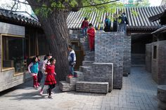 2016 Aga Khan Award for Architecture Winners Announced,Hutong Children's Library and Art Centre / ZAO / standardarchitecture / Zhang Ke. Trail of brick stairs leads up to the roof, where children and parents can delve into the branches and foliage of the big tree. Image © AKTC / Zhang MingMing, ZAO, standardarchitecture