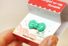 Green bowtie earcap / dust plug for your phone.  Buy now for only $3.99!