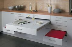 45 Creative Small Kitchen Design Ideas | DigsDigs- COOL! If the space you live in is extremely small, why not build in a pull out table and seating drawer for eating.