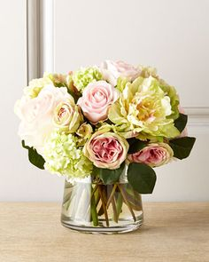 "Pastel Passion Faux Floral at Neiman Marcus.  Faux roses, peonies, and other pink and white flowers in glass container with acrylic ""water."" $456"