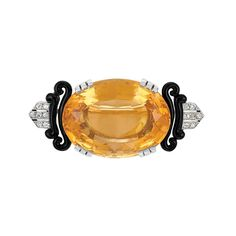 Citrine, Black Enamel and Diamond Brooch   White gold, platinum, centering one oval citrine ap. 39.50 cts., flanked by two pairs of black enamel scrolls and six rose-cut diamond-set bars, minor enamel loss, circa 1920, approximately 12 dwt.