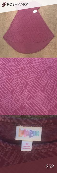 NWT Lularoe Carly dress New Lularoe Carly dress, size medium see sizing chart for sizing recommendations. Solid purple rose colored, Jaquard fabric. ***Price is firm below retail*** LuLaRoe Dresses Asymmetrical