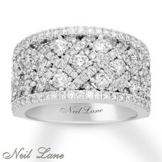 From Neil Lane Bridal®, this spellbinding anniversary band for her showcases dazzling round diamonds displayed between crossed lines of sparkling diamonds. The ring is styled in polished 14K white gold and has a total diamond weight of 2 carats. Neil Lane's signature appears inside the band. Diamond Total Carat Weight may range from 1.95 - 2.11 carats.