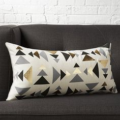 "Shop blaney 23""x11"" pillow.   Tonal triangles in black and grey point in a modern direction to metallic gold foil.  Digitally printed on a natural field of cotton/linen, oblong pillow reverses to solid grey cotton."
