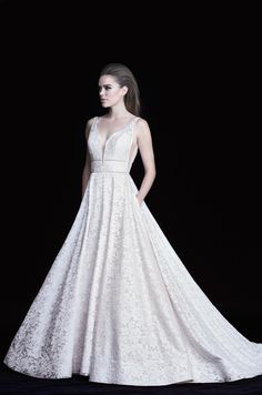 Glamorous Lace Wedding Dress - Style #4754 from Paloma Blanca. Lace gown with plunging neckline. Double beaded bands. V-shaped inserts at side seams.