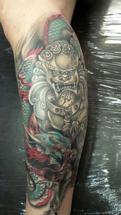 Dragon and foo dog tattoo by tyrone inkslinger