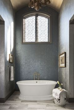 A window completed by Fashion Glass & Mirror is a stunning focal point in this bathroom. #luxeDallas