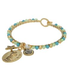 "7"" gold tone hook style bangle featuring a sea life themed charm decor accented by mint green, turquoise, and gold tone beads."