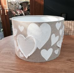 Heart lampshade made from natural linen and cotton blend fabric.  This is made by using a lampshade making kit. I painted the fabric (before making the shade) with white hearts adding a few appliqued ones in white linen to give it some depth. I have made this shade by request, not sure I would do QUITE so many hearts if I was to do it again. Very time consuming.