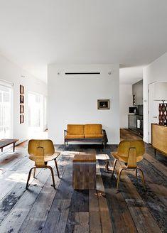 Herman Miller Eames Plywood Lounge Chair + Reclaimed Wood Floors.