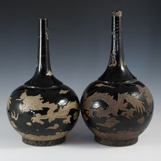 Lot #206: Chinese Earthenware Noir Glaze DESCRIPTION: Pair of Chinese earthenware porcelain noir glaze vases incised with dragon figures along the body. The vases feature a bulbous base tapering to a long skinny neck.  CIRCA: late 19th to early 20th century ORIGIN: China DIMENSIONS: 16″ H
