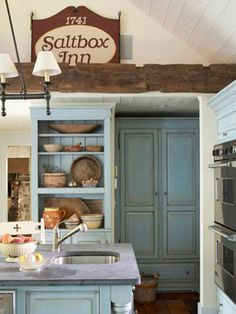 This just might be a great idea to remove my door on my small kitchen cabinet. French blue unifies the unfitted cabinetry with the built-in pieces, with gray soapstone counters to complement. Country Kitchen, New Kitchen, Vintage Kitchen, Kitchen Dining, Kitchen Decor, Spanish Kitchen, French Kitchen, Rustic Kitchen, Kitchen Interior