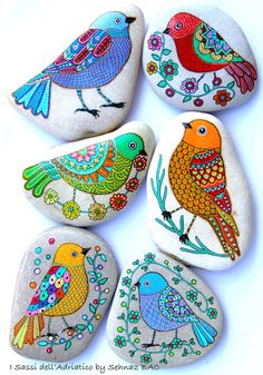 Hand Painted Stone Bird Beach Stone with hand-painted designs in acrylics © Sehnaz Bac 2015 I paint and draw all of my original designs by hand with the small brushes or paint pens with extra fine tip. I use also isographs with different inks. No stencils are used. All designs are created with my imagination. These pebbles were found on the beaches of Adriatic Sea. Each was chosen for its shape, smoothness and uniformity. They are protected with 2 or 3 layers of high quality glossy acrylic…