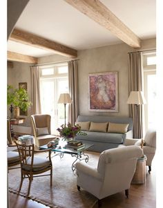 Relaxed Seating - contrasting pillows on sofa, simplicity - no pattern anywhere lends belgian feel