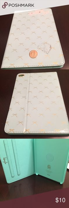 Mini I PAD case... mint green w/ gold colored bows NWT, the spot you see on the front is from leaving the tags on too long. Will come clean. Adorable case... Accessories Tablet Cases