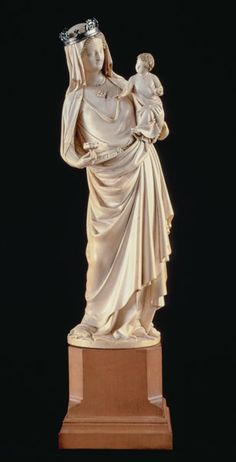 """Taft Museum's """"Virgin and Child"""", Paris, about 1260-80.  One of the most important surviving medieval ivories,  produced for Saint-Denis,  birthplace of Gothic architecture and burial site of French kings. With her right knee bent to support Christ, the Virgin's pose reflects the shape of the elephant tusk from which it was carved.   In 1811 following the French Revolution, this confiscated  treasure was sold, and the Virgin's original gold-and-jeweled crown and emerald brooch were lost."""