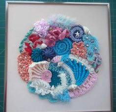 Seaside scrumble made my me, mostly crochet a little knitting, embellished with beads, shells etc.