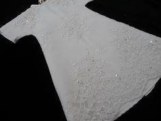 Angel gown with beaded lace overlay.