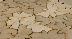 laser cut wooden floor tiles inspired by Escher
