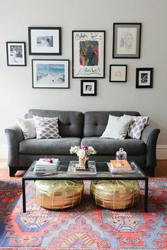 A mix of colorful textiles and quirky gallery wall really tie this living room design together. Play around with patterns and textures in your own home, especially if you've got modern neutral-colored furniture. The result is an inviting, eye-catching space that will be easy to redecorate whenever the mood strikes!