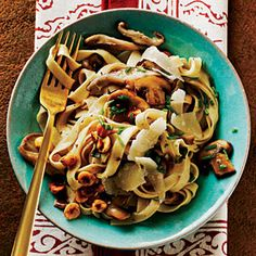 fettuccine with mushrooms & hazelnuts; but i used capellini noodles & threw in some arugula instead of chives.