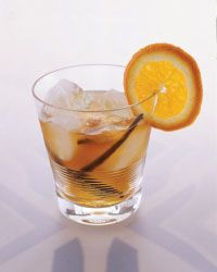 Vanilla Old-Fashioned       One 1-inch piece of vanilla bean, split     One 1-inch piece of orange zest     1/4 ounce Simple Syrup     2 dashes of orange bitters     2 ounces bourbon     1 orange wheel