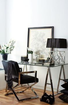 modern and glamorous writing desk and chair.  The metallic accents and black details keep this very chic.
