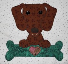 Dachshund applique wall hanging.  Dog quilt.