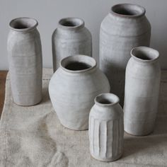 Dolomite bottles and jars Handbuilt with coils in sanded buff clay with matte dolomite glaze 2015