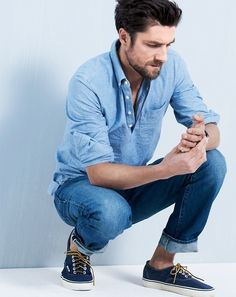Chambray 3 button Shirt, vintage Jeans, and Navy Sneakers. Men's Spring Summer Fashion.