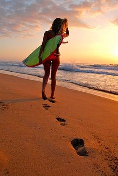 Beach, surf board, pretty girl.  Perfect day.  Go to www.YourTravelVideos.com or just click on photo for home videos and much more on sites like this.