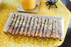 Bee Theme Party Ideas.  I like the idea of using yellow on the pretzel rods.