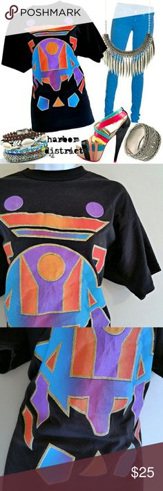"SOLD - Vintage 80s Geometric Tee - Size L or OS Amazing black teeshirt from the 1980s featuring a neon geometric print. Bold shades and gold glitter. In perfectly worn-in vintage condition. Eye-catching and unusual; so authentically retro.  Bust - 42"" Waist - 41"" Length - 29"" Label - One Stop Size - Vintage One Size, estimated modern L or OS (PLEASE CHECK MEASUREMENTS) Materials - Polyester, cotton  Color may vary slightly.   #vintage #retro #vintagetee #vintageteeshirt #80s #90s #1980s…"