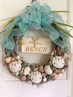 Beach Wreath Sand dollar and Shell Wreath Summer by FloralXchange, $48.00