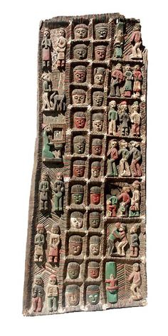 Africa | Yoruba (Nigeria) doors, often made by well-known carvers for prestigious homes and palaces, usually have strong figurative carving in deep relief. This one retains most of its original paint as well | © Tim Hamill