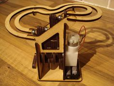 Items similar to Sale: Laser Cut Marble Machine Kit on Etsy Rolling Ball Sculpture, Marble Machine, Laser Cutter Projects, Diy Cardboard, Knife Block, Laser Cutting, Wooden Toys, Woodworking, Cool Stuff