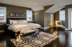 master bedroom with beautiful wood flooring