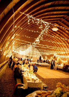 Inside a Rustic Barn Wedding Decorated With Fabulous Ceiling Lights / http://www.deerpearlflowers.com/barn-wedding-reception-table-decoration/2/