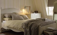 A homely room  Create a really warm and cosy bedroom by using hints of the yellow with lots of ecru and pale neutrals. This lovely, inviting scheme would work well in most rooms.