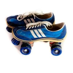 I had a pair of these...only difference was my wheels were yellow. Vintage Roller Skate Shoes Sneakers Womens Mens Rollerskates